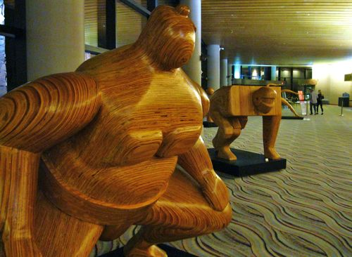 Large_wood_ sumo wrestler sculptures